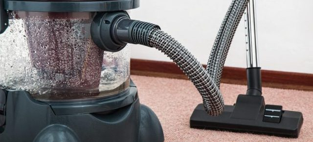 Vaccum cleaner on a carpet.