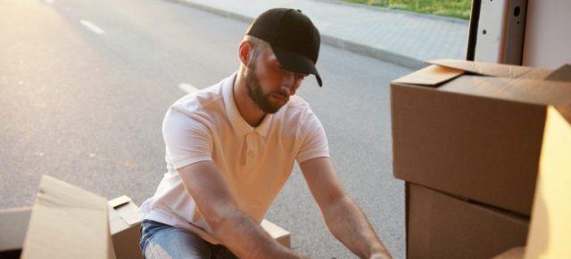 Man checking a moving list.
