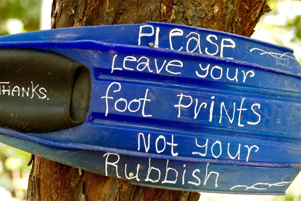 A sign reminding tourists not to leave their rubbish