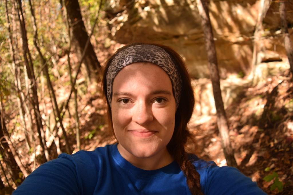 samantha standing along hiking trail