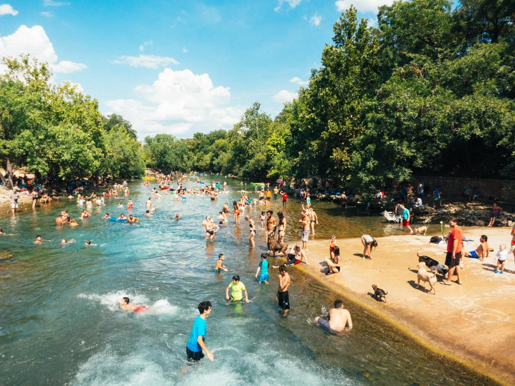people swimming in a natural spring
