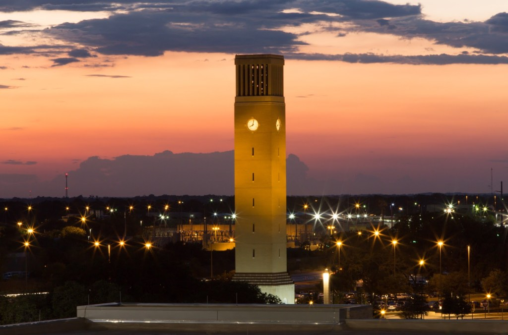 the college station bell tower at sunset