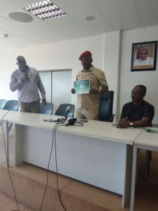 Olajide Fashikun ushering Sports Minister, Solomon Dalung at the ceremony