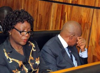 Justice Adeniyi Ademola and wife...hiding the face from poking cameras