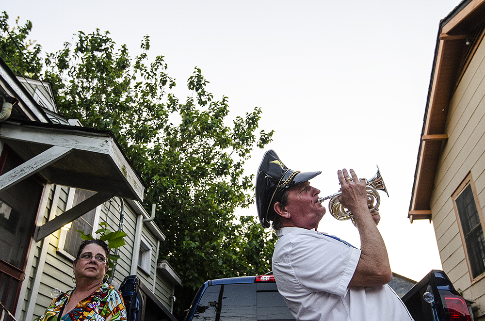 April 22, 2016 - New Orleans, LA: Attendants of the New Orleans Jazz and Heritage Festival spill out of every exit into growing street parties on each of the nearest streets following the fest. Many musicians bring their instruments and play impromptu sets, inlcuding this man who played his trumpet for passersby on Mystery Street. (Photo by Katie Sikora)