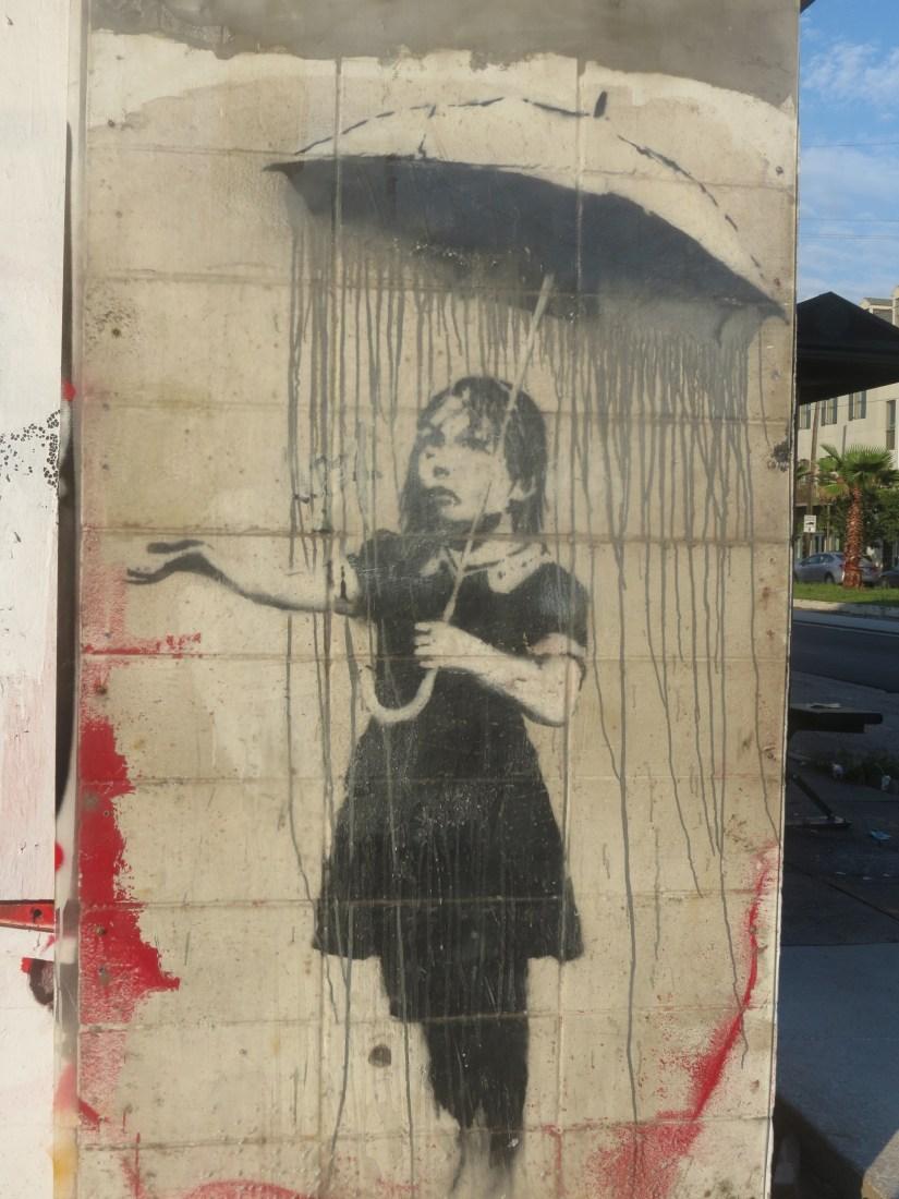 Banksy's girl with umbrella (photo by Emily Ramirez Hernandez)