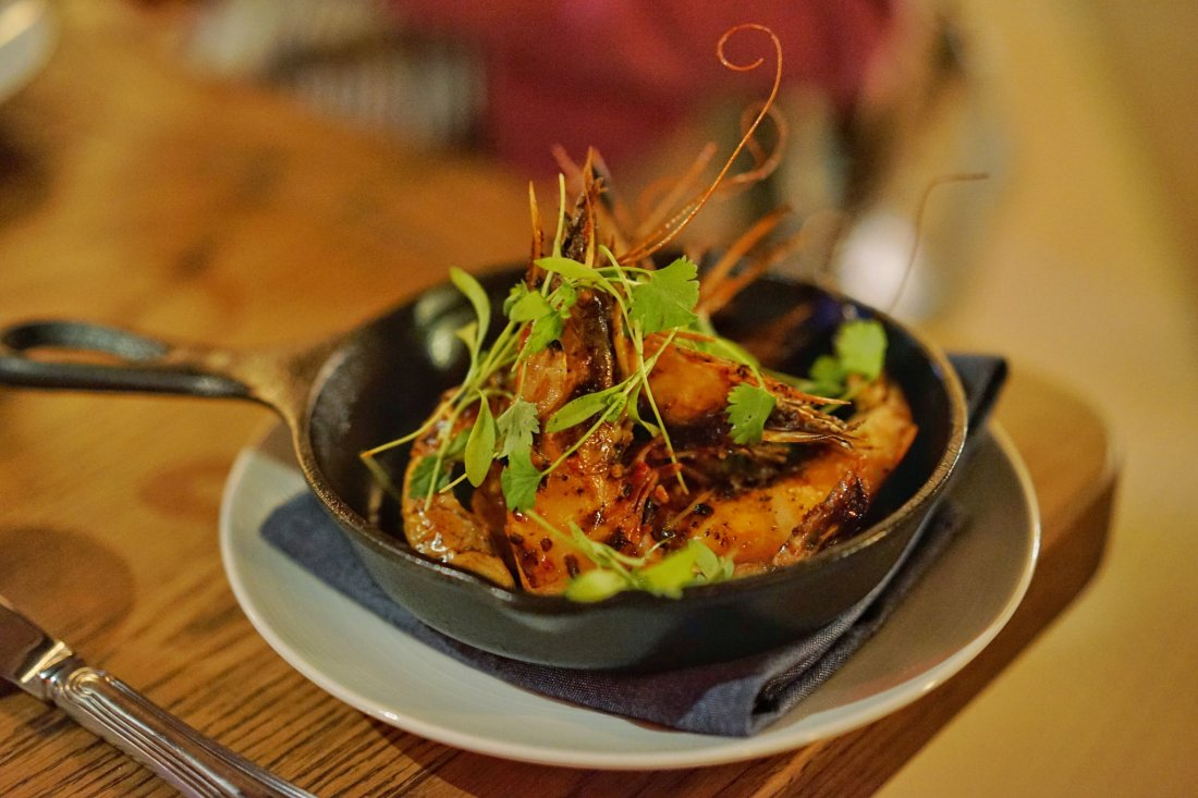 Chef Nina Compton of Compere Lapin hails from the Caribbean island of St. Lucia, and its influences are all over her menu, including this first course dish of broiled Louisiana shrimp with Calabrian chili butter.