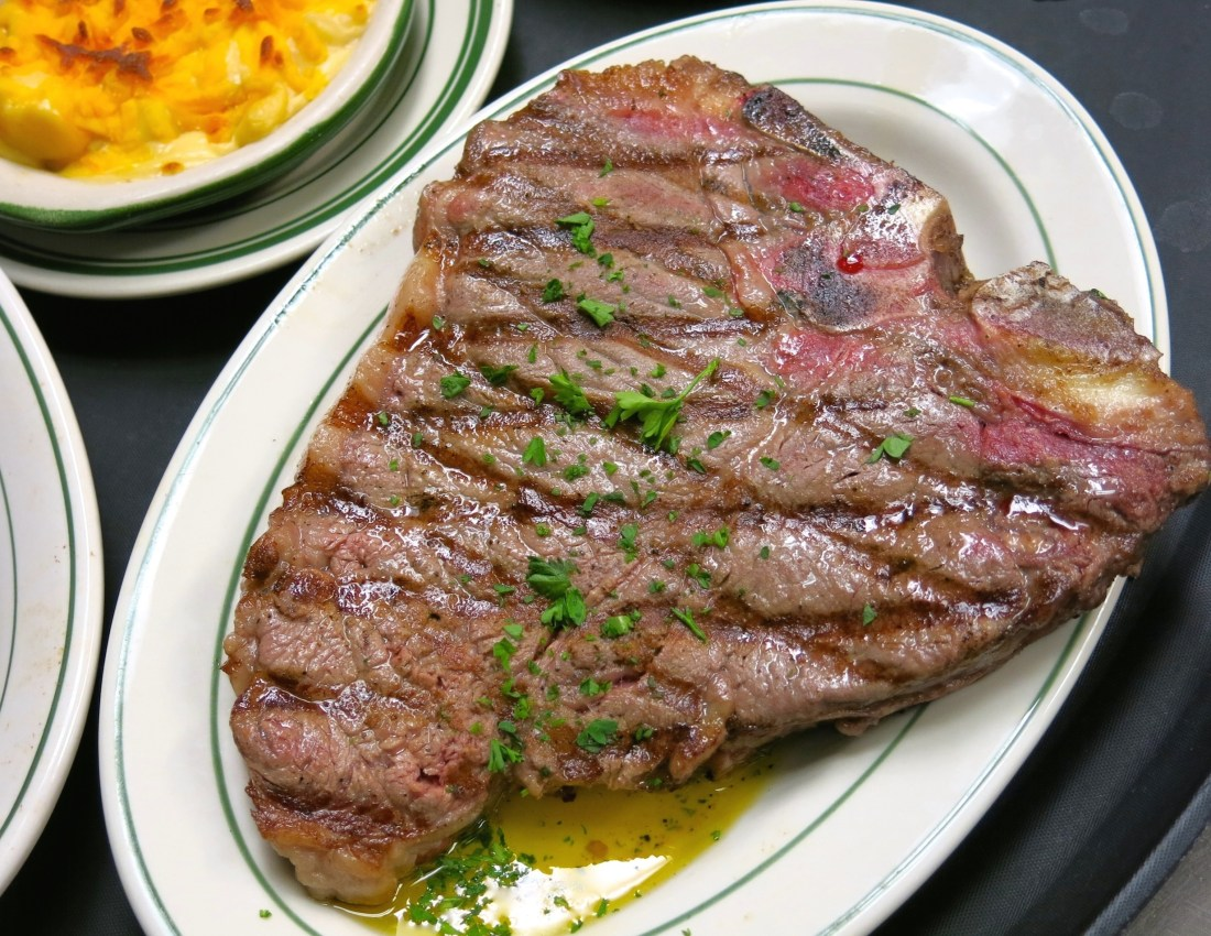 (Steak fresh off the grill at Crescent City Steak House. Photo credit: Christopher Garland.)
