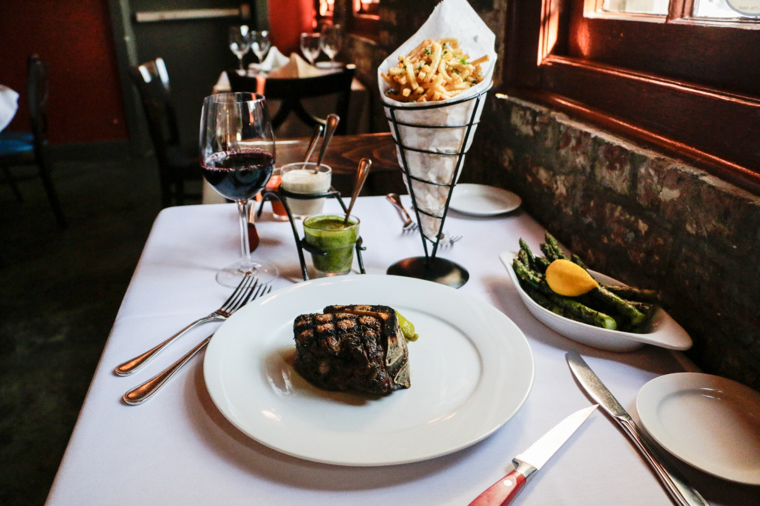 Steak, French fries, and asparagus at La Boca. (Photo: Rebecca Ratliff)