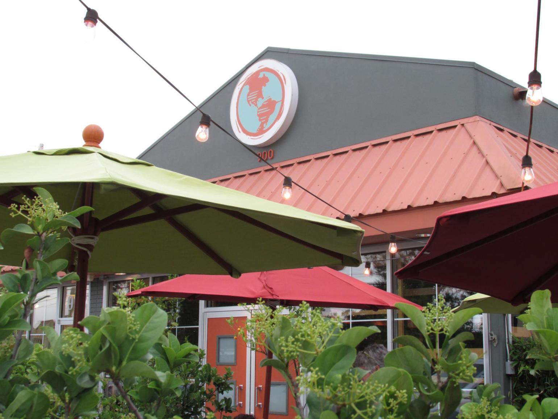 The lush outdoor space at Mondo is an ideal setting to enjoy their sumptuous cheeseburger. (Photo via Mondo on Facebook)