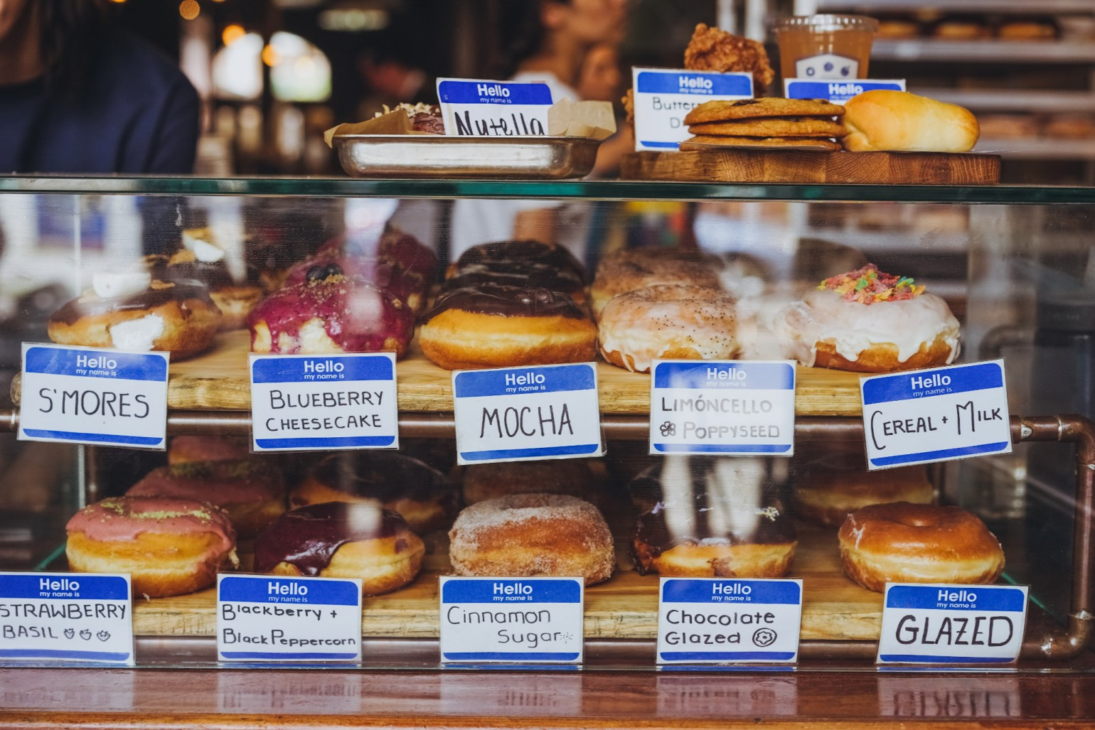An array of flavored donuts at the popular pastry joint, District Donuts. (Photo: Paul Broussard)