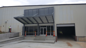 Perforated metal panels installed on entry canopy