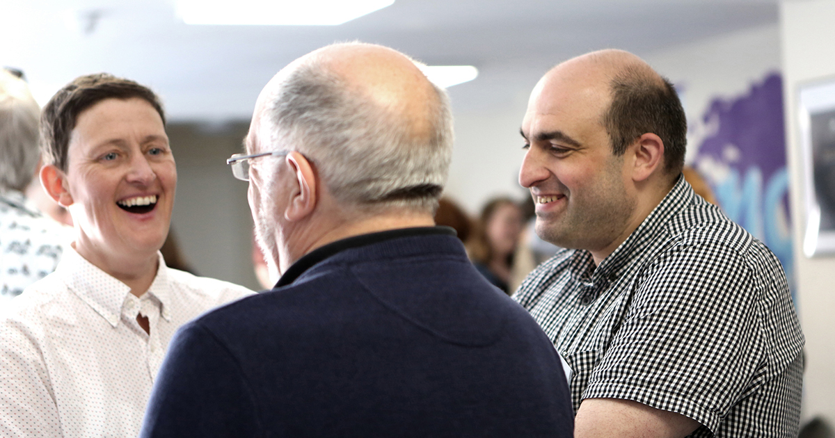 Nigel Honey and Claire Carpenter smiling at the Good Ideas Incubator Marketplace