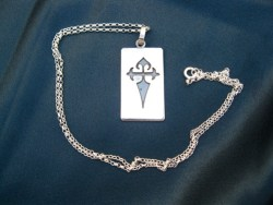 St James symbolic dog tag