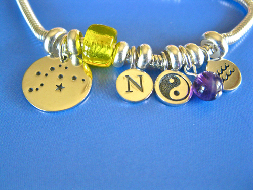 Camino bracelet for an Aquarius with Amethyst birthstone, Yin Yang symbol charm and letter N
