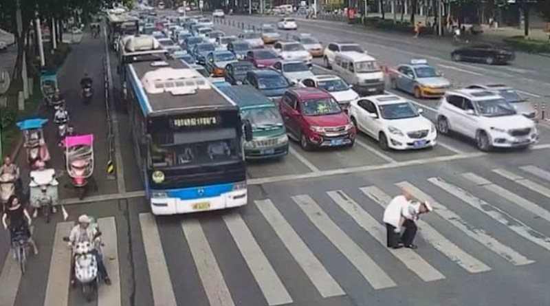 Cop Carries Elderly Man Across Busy Road On His Back