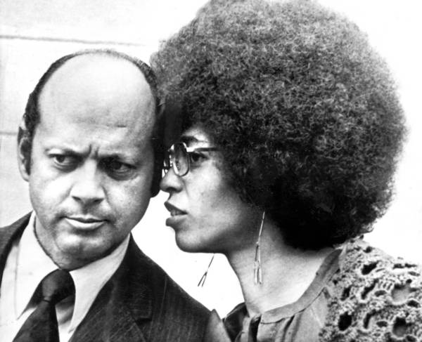April 6, 1972: Defense attorney Leo Branton listens to Angela Davis as the two walk from court at San Jose. For obit of Branton.