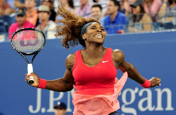 Serena Williams of the US celebrates her win over Victoria Azarenka of Belarus during their 2013 US Open women's singles final match at the USTA Billie Jean King National Tennis Center September 8, 2013 in New York. AFP PHOTO/Stan HONDASTAN