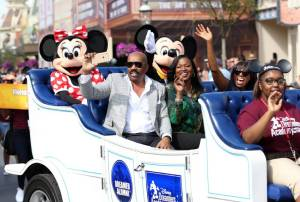 Steve Harvey, Disney VP Tracey Powell, Essence Editor-at-Large Mikki Taylor, a Dreamer and Minnie Mouse in Disney Dreamers Academy Parade on Opening Day