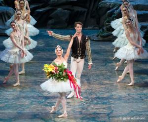 "This photo provided by American Ballet Theater, Misty Copeland and James Whiteside acknowledge the audience after appearing  in ""Swan Lake"" at the Metropolitan Opera House on June 24, 2015. It was Copeland's New York debut in the lead role, a key moment for her fans who hope she'll soon be named American Ballet Theater's first black principal dancer. (Gene Schiavone/American Ballet Theater via AP)"