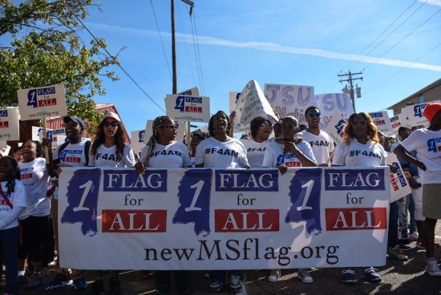 Initiative #55 supporters march towards the Mississippi State Capitol Sunday October 11, 2015 in Jackson, Miss. Initiative 55 is the Flag for All Mississippians Act which proposes removing the Confederate Battle flag from the Mississippi State flag. (photo via