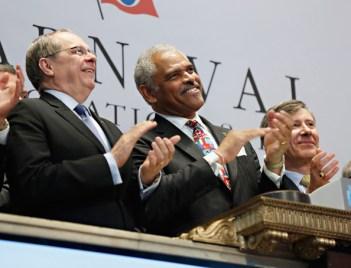 Carnival CEO Arnold W. Donald (center) rings New York Stock Exchange Bell (photo via zimbio.com)