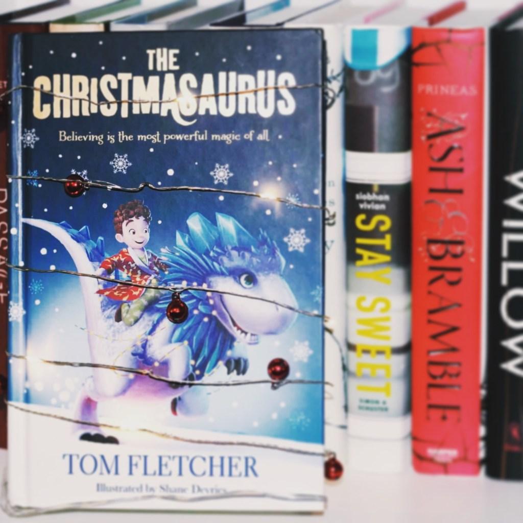 The Christmasaurus is OVER THE TOP with Christmas spirit. William's dad is into Christmas like all year round. He has this saying about how the day after Christmas is 364 days until the next Christmas. And plus, it nails that melancholy that hits when Christmas is over. Also, we have Santa and elves and changes of heart. All the elements are definitely within this book which add up to ALL SORTS OF SPIRIT.