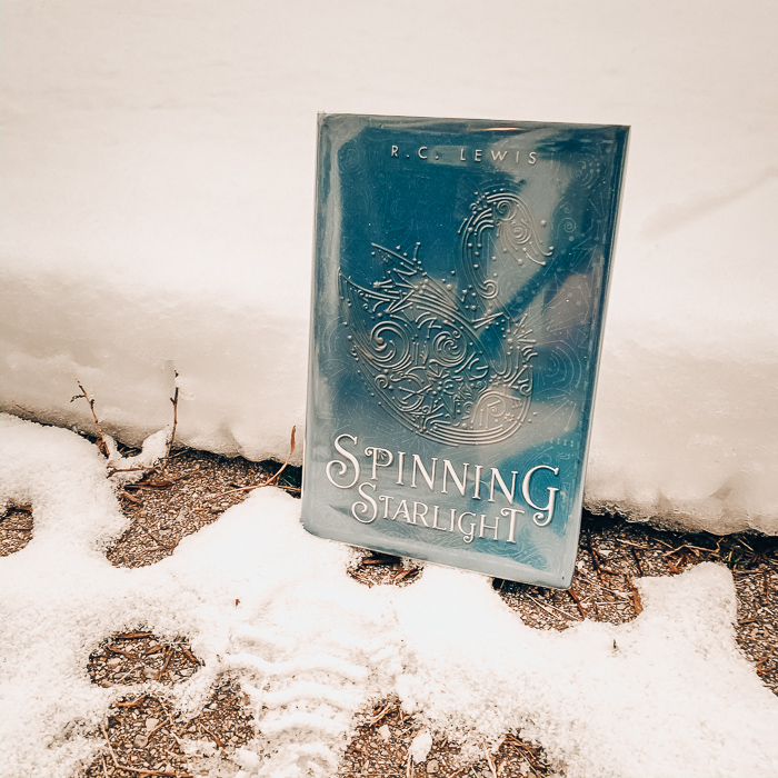 Spinning Starlight by RC Lewis is a sci-fi retelling of the Wild Swans - the story where the girl can't talk and has to make needle fir shirts for her seven brothers. Well, this story definitely is a unique take on the fairy tale.