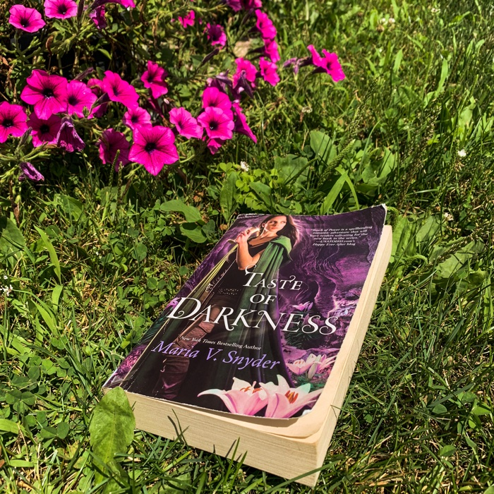 Taste Of Darkness by Maria V. Snyder is the conclusion to Snyder's Healer trilogy and friends, I think maybe I might have had a different experience with this book had I chosen to read it closer to the previous two books in this trilogy.