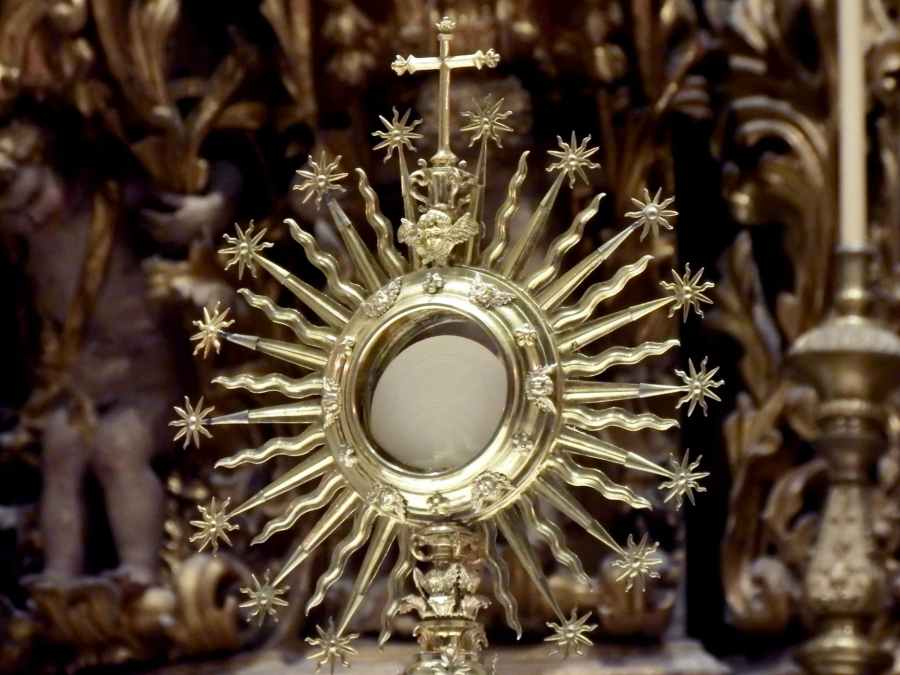 golden monstrance against blurred church interior