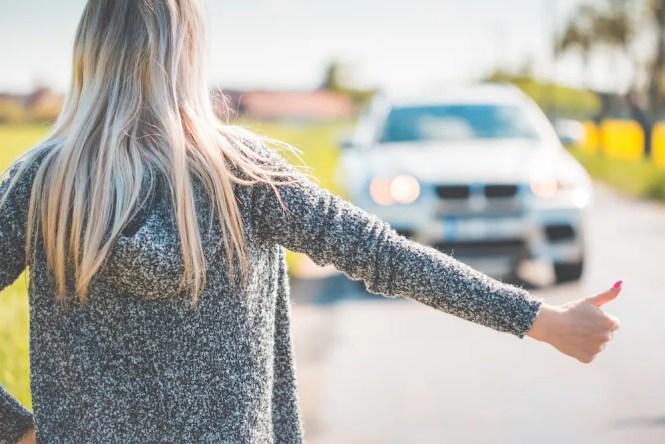 blonde-woman-hitchhiking-because-of-her-broken-car-picjumbo-com