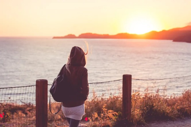 young-girl-on-a-walk-near-the-shore-at-sunset-picjumbo-com