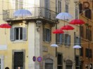 Umbrellas floating over a street near the French Embassy.