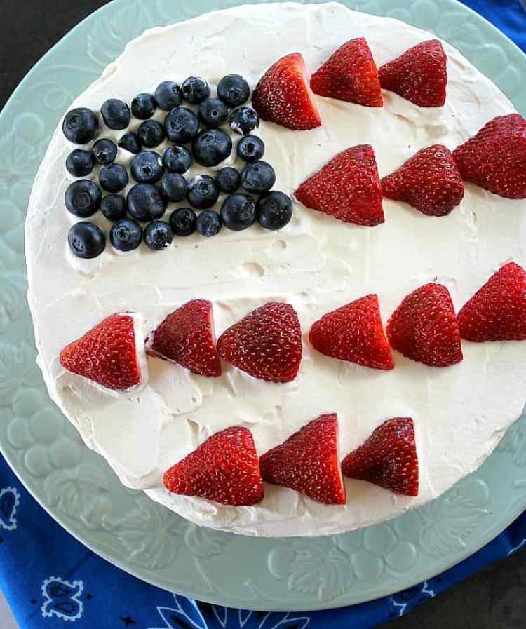 A fresh version of Poke Cake with whipped cream frosting and no artificial colors or gelatin. Only natural berry syrups.