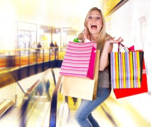 Woman with shopping obsession holding bags