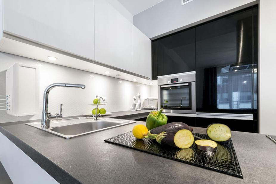 Modern design kitchen with electric appliances and stone worktop