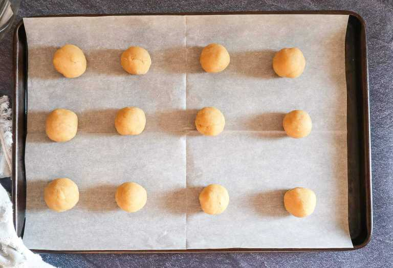 gluten free thumbprint cookies rolled into balls for baking