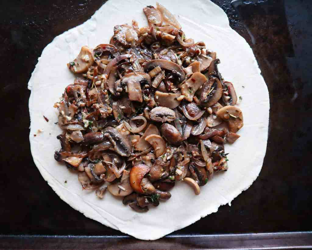 Making a mushroom galette
