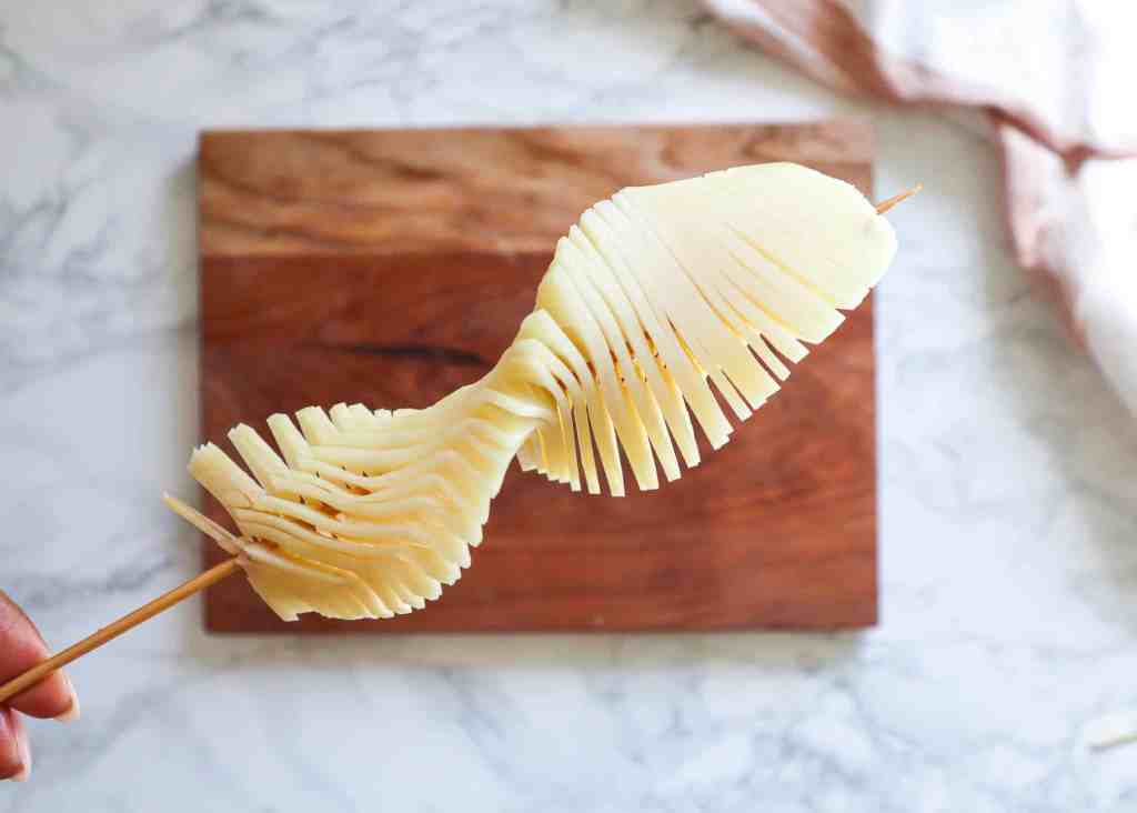 image of a raw sliced potato on a stick to show accordion pattern