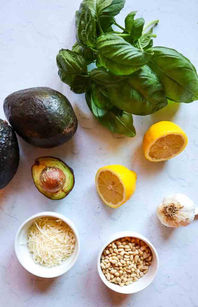 Ingredients to make creamy avocado pesto