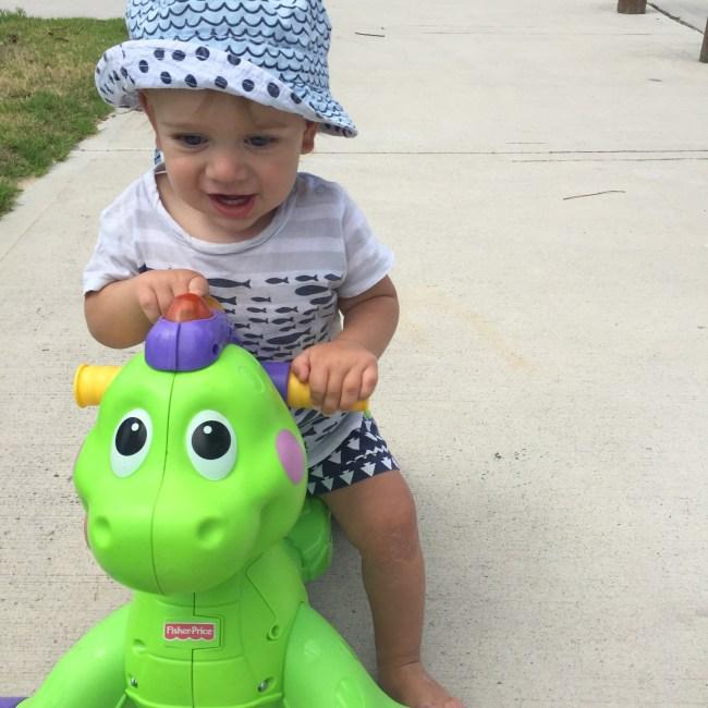 The Little Dude riding a dinosaur