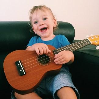 The Little Dude playing a ukulele