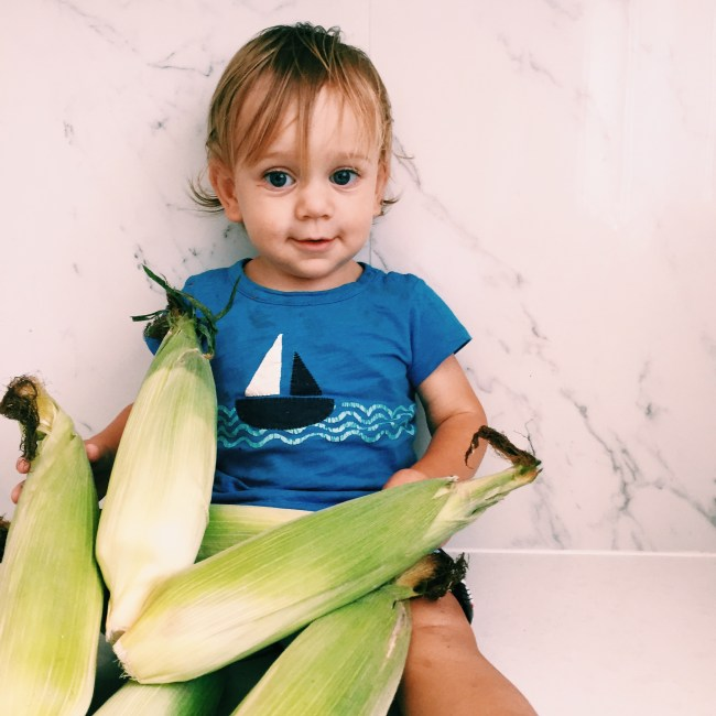 The Little dude and corn from the Farmer's Market
