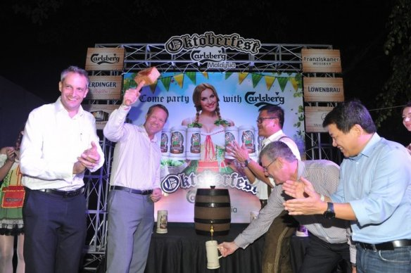 In keeping with tradition, festivities started with the tapping of a fresh keg of beer. Carlsberg Malaysia's Managing Director Henrik Juel Andersen [second from left] is joined by [from left to right] Kai Schlickum, Vice President of Sales & Marketing of Mercedes Benz Malaysia; Kenneth Soh, General Manager of Luen Heng Sdn Bhd; Peter Hourigan, General Manager and Vice President of Saujana Resort Kuala Lumpur; and Philip Tan, Area Manager of Anheuser Busch InBev International.