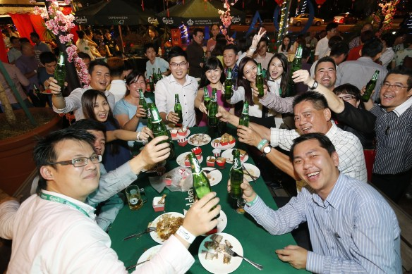Cheers! - Guests were all smiles at the Carlsberg 2015 CNY launch.