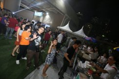Guests helping themselves to an array of street food.