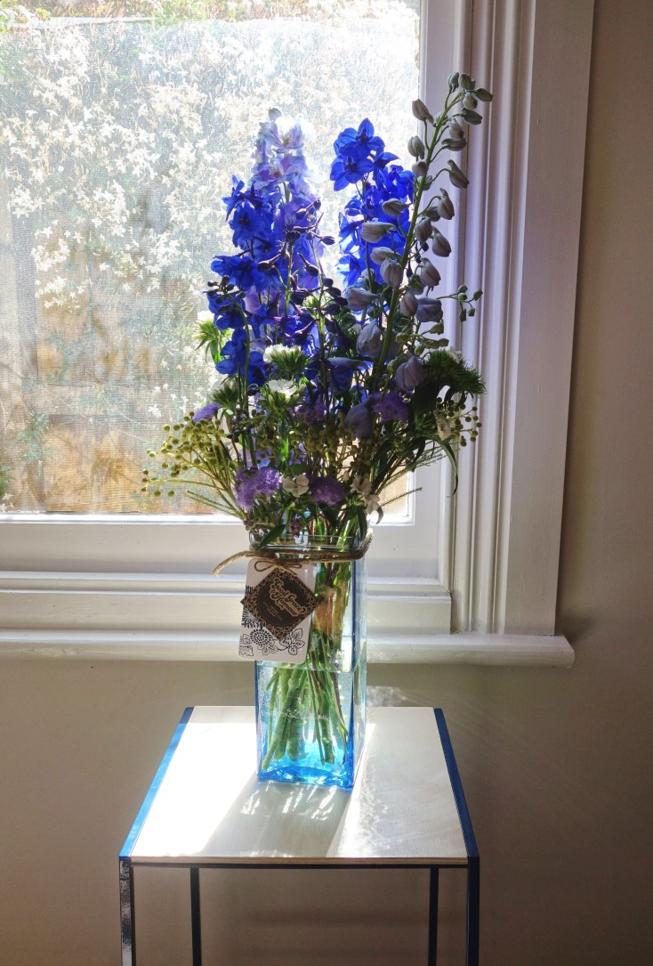 Delphiniums, sweet william, ageratum & berzelia arrangement