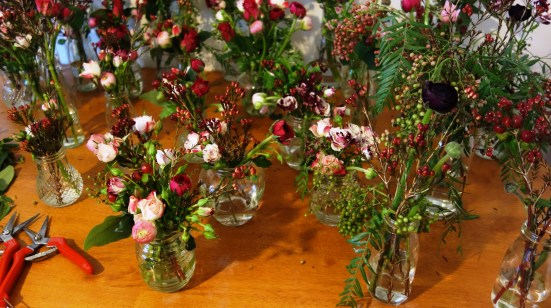 Flowers in multiple glass vessels