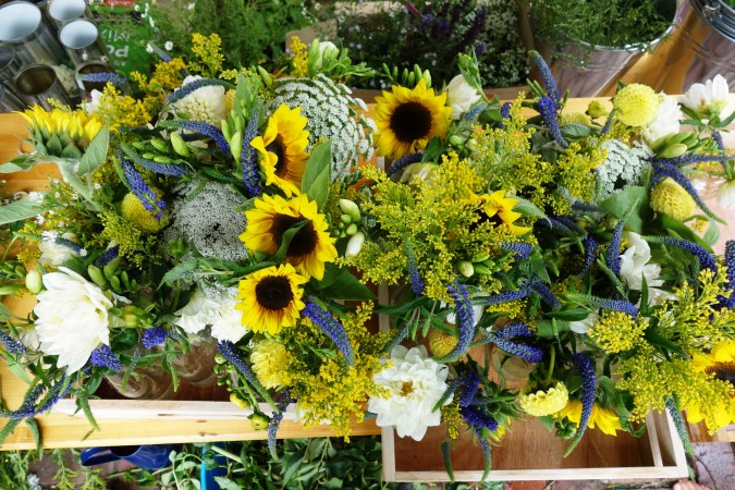 Sunflowers, veronica, dahlias, golden rod, Queen Anne's lace and freesias in glass vessels