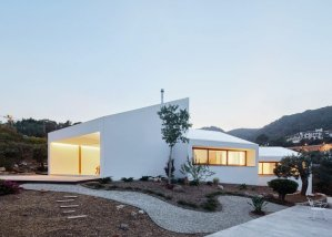 Four angular white volumes form house in Mallorca by OHLAB